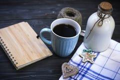 Todavía de RFestive vida con una botella, una taza, un cuaderno Imágenes de archivo libres de regalías