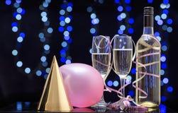 Todavía escena del partido de la vida de globos, de sombreros y del champán Foto de archivo libre de regalías