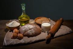 Todavía foto de la vida del pan y de la harina con leche y huevos Imágenes de archivo libres de regalías