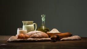 Todavía foto de la vida del pan y de la harina con leche y huevos Fotografía de archivo libre de regalías