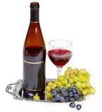 Todavía vida - botella de vino, de vidrio y de uvas Foto de archivo libre de regalías