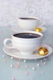 Todavía vida con café y chocolates Fotos de archivo libres de regalías