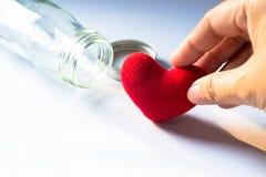 Todavía vida con el corazón en la botella de cristal Fotografía de archivo