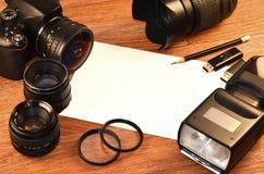 Todavía vida con el equipo digital del photocamera Foto de archivo