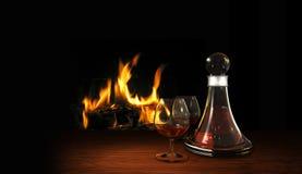 Todavía vida con el lugar del aperitivo o del digestif y del fuego Fotos de archivo libres de regalías