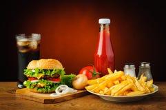 Todavía vida con el menú de la hamburguesa Fotografía de archivo libre de regalías