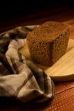 Todavía vida con el pan de centeno, espigas de trigo Foto de archivo libre de regalías