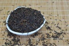 Todavía vida con el té presionado PU-erh Foto de archivo libre de regalías