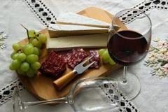 Todavía vida con el vino, queso suave Imagen de archivo libre de regalías