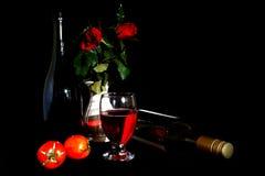 Todavía vida con el vino y los tomates Foto de archivo libre de regalías