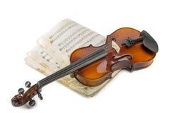Todavía vida con el violín y el cuaderno musical viejo Fotografía de archivo