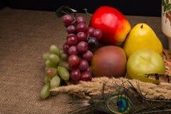 Todavía vida con la fruta artificial Fotos de archivo