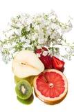 Todavía vida con la fruta y las flores Imagen de archivo libre de regalías