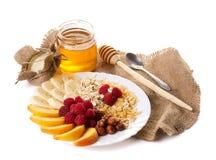 Todavía vida con la miel, las frutas nuts y las escamas Fotos de archivo libres de regalías