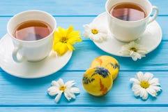 Todavía vida con la taza de té y de torta Foto de archivo libre de regalías