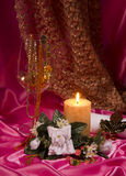 Todavía vida con la vela, el vidrio y las flores Fotografía de archivo libre de regalías