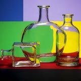 Todavía vida con las botellas en coloreadas Foto de archivo libre de regalías