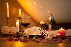 Todavía vida con las velas y el vino rojo Imagen de archivo libre de regalías