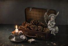 Todavía vida con los conos, los libros y las velas Foto de archivo libre de regalías