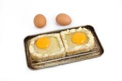 Todavía vida con los productos lácteos, los huevos, el pan y el queso Imagen de archivo libre de regalías