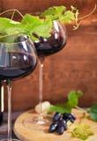 Todavía vida con los vidrios de vino rojo Fotografía de archivo libre de regalías