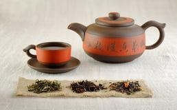 Todavía vida con tres pilas de té Foto de archivo libre de regalías
