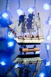 Todavía vida con un barco de vela Imagenes de archivo