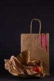 Todavía vida con un paquete y melocotones Imagen de archivo libre de regalías