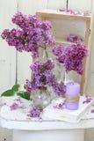 Todavía vida con un ramo de lilas y de vela Fotografía de archivo libre de regalías