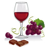 Todavía vida con un vidrio de vino, de uvas y de chocol Imagen de archivo libre de regalías