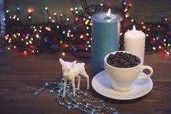 Todavía vida con una taza y las velas de café Fotografía de archivo libre de regalías