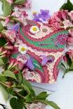 Todavía vida de flores y del cuaderno Foto de archivo