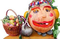 Todavía vida de la fruta y verdura. Calabaza en la cabeza la forma de la mujer. Fotos de archivo
