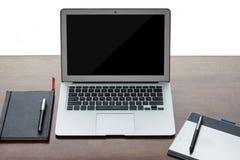 Todavía vida del escritorio de trabajo con electrónica Foto de archivo
