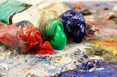Todavía del arte vida - primer de tres tubos de la pintura de aceite Imágenes de archivo libres de regalías
