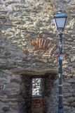 The architecture of Kavala. Window-recess from the fortress in the Old Town - detail. With a street lamp. stock image