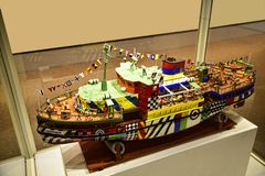Model of Dazzle boat at the museum in the Albert Dock is a complex of dock buildings and warehouses in Liverpool, England. Royalty Free Stock Photos