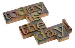 Today is the day!. Words in vintage wooden letterpress printing blocks, stained by color ink, isolated on white stock photo