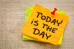 Today is the day reminder. On a sticky note against burlap canvas royalty free stock photography
