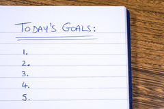 Today Goals Checklist. Checklist for todays goals written on a notepad Stock Photo