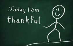 Today I am thankful. On the blackboard draw character and write Today I am thankful stock photo