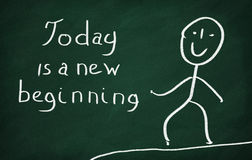 Today is a new beginning. On the blackboard draw character and write Today is a new beginning royalty free stock photo