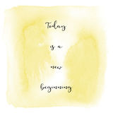 Today is a new beginning on yellow watercolor background Royalty Free Stock Photo