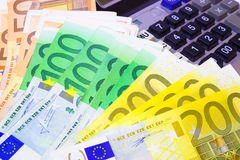 Today's Earnings. Banknotes of the European Union in addition to the calculator, photography Royalty Free Stock Photos