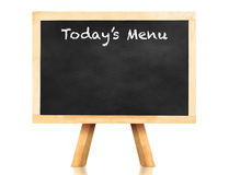 Today's menu word on blackboard with easel and reflection on whi Royalty Free Stock Image