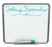 Today's Special - Blank White Dry Erase Board. A white dry erase board reading Today's Specials with blue marker, with plenty of blank copy space for your Stock Photos