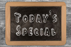 Today's special - chalkboard with outlined text. On wood Royalty Free Stock Image