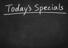Today`s specials. On blackboard background Stock Images