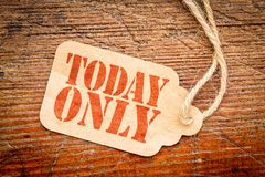 Today only sign on price tag. Today only sign - red stencil text on a cardboard price tag against rustic wood stock image