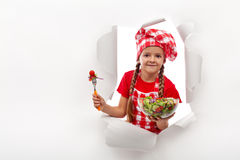 Todays menu - little girl presenting vegetable salad. With copy space royalty free stock photo
